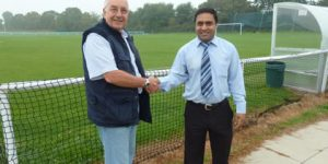 Tony Eden receives a sponsorship cheque from Salim Uddin