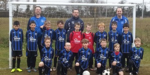 Eagles U9s Reds and Whites kit donated by Install Property Solutions